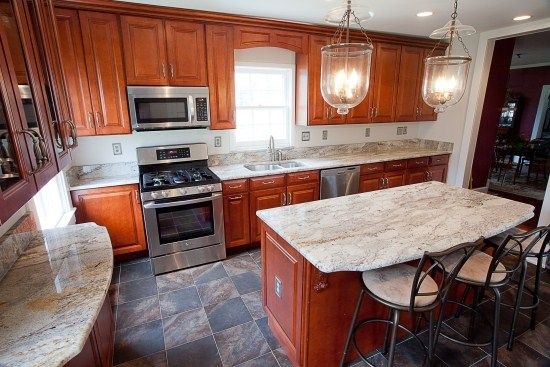 honey oak kitchen cabinets with black countertops | White Cabinets ...