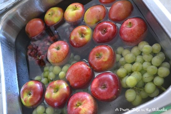fill sink with water, add 1 C. vinegar, mix.  Add all fruit and soak for 10 minutes.  Water will be dirty and fruit will sparkle with no wax or dirty film. Great for Berries too--keeps them from molding.  I do this with strawberries and they last for weeks!