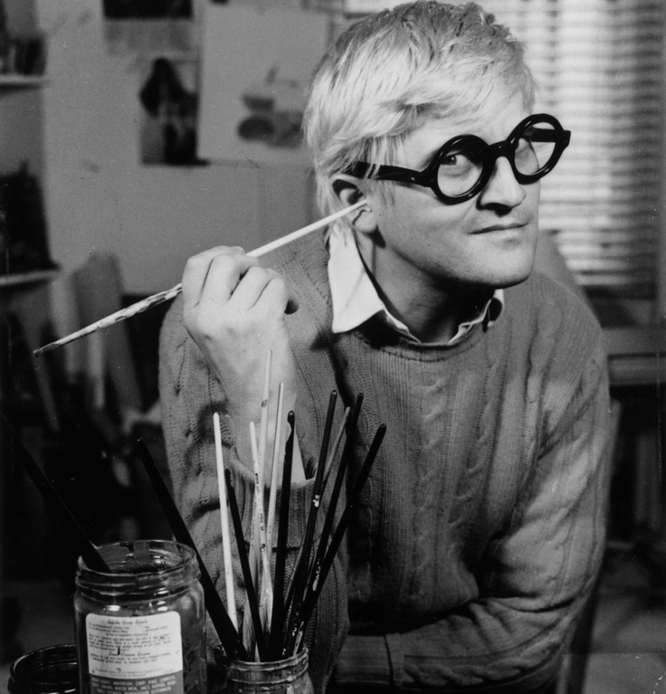 English pop artist, printmaker, stage designer, and photographer David Hockney in his Bayswater studio just after Jonathan Cape published 72 of his drawings in book form, November 1971. (Francis Goodman/Getty Images)
