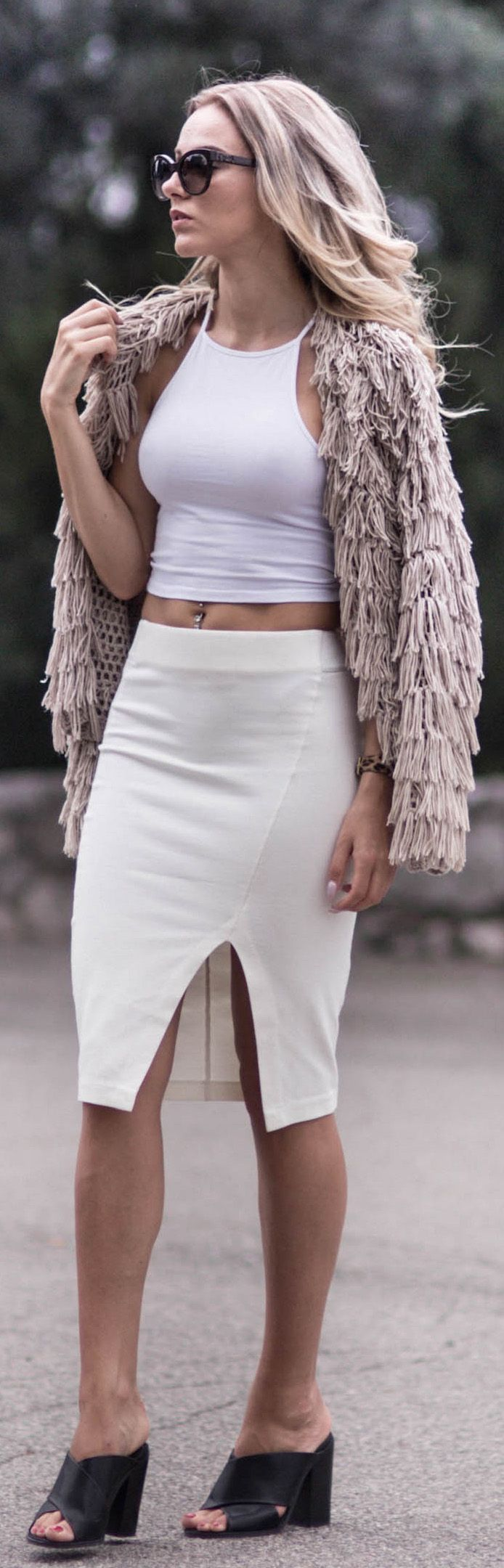 Via Just The Design: Sendi Skopljak is wearing a Lindex faux fur jacket, a NYL crop top and a creme body con skirt