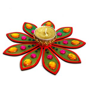 Floral Glow Beautiful ready made rangoli decked with splashy stones and a diya. Rs. 449 ($7.36) http://www.tajonline.com/diwali-gifts/product/d3884/floral-glow/?aff=pint2013/