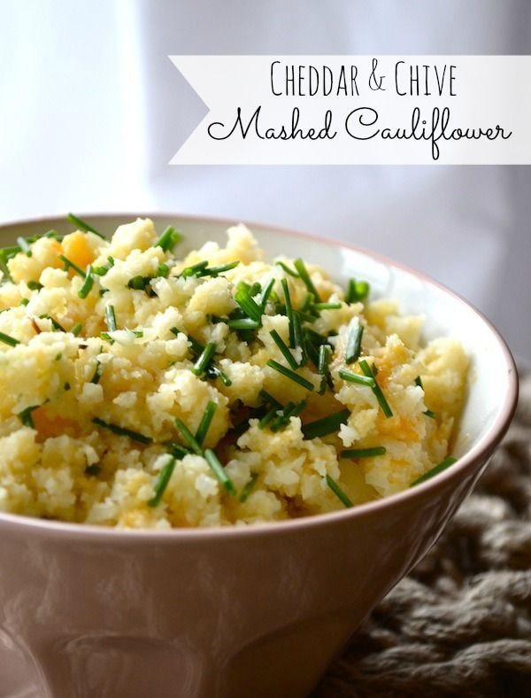 Cheddar & Chive Mashed Cauliflower. just like mashed potatoes without all the carbs.