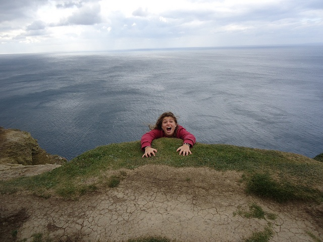 Hanging on for dear life at the Cliffs of Moher in Ireland ;) - Michelle Gilman | Flickr - Photo Sharing!