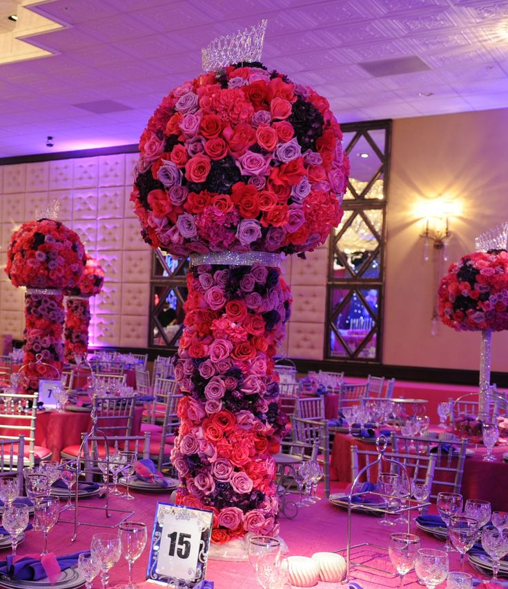 Red Pink and Purple centerpiece with a crystal tiara and wrapped in crystals. #wedding #decor #flowers #design