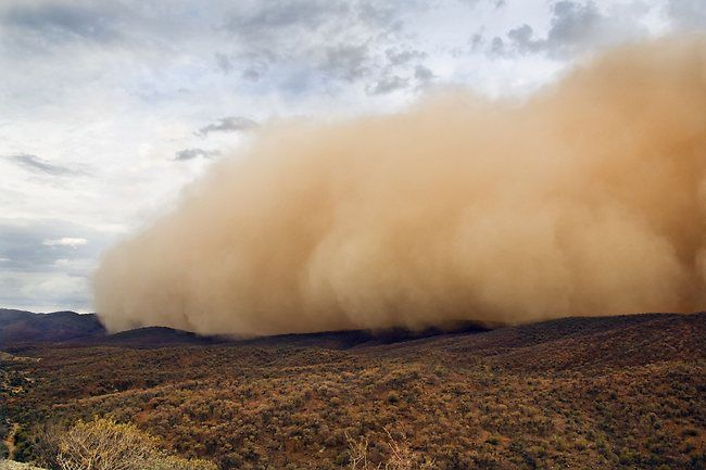 A wall of dust - A massive dust storm rolls over the Arkaroola Wilderness Sanctuary in the northern Flinders Ranges of South Australia. Photographer: Peter MacDonald. Picture: Bureau of Meteorology