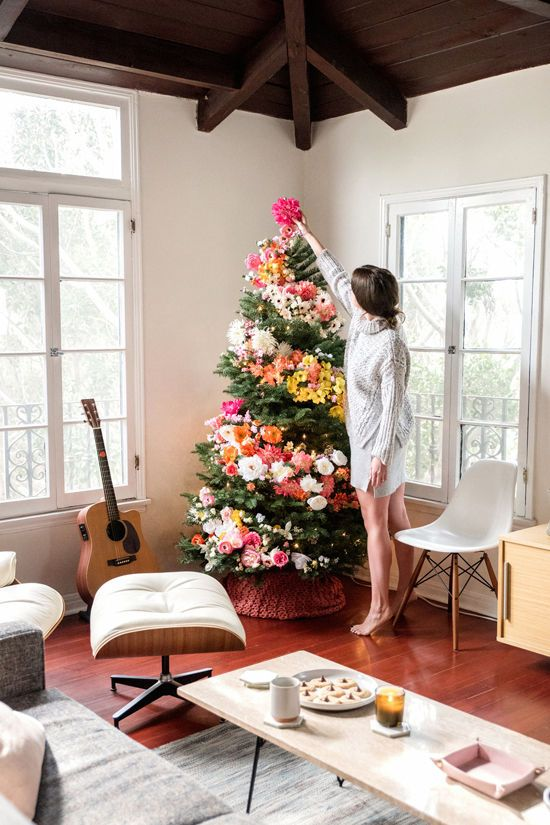 DIY: Floral Tree. Take a new twist this holiday, and throw out your ornaments. Go with this organic look that still brightens up your room.
