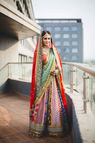 Bridal Lehengas - Multicolored Bridal Lehenga | WedMeGood | Multicolored Paneled Wedding Lehenga with Double Dupattas, Red Net and Mint Green Dupatta with Scattered Sequin Work #wedmegood #indianwedding #indianbride #lehengas #bridal #