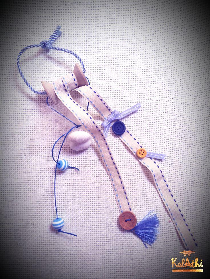 Wooden bobbin with ribbons & buttons by KalAthi photo © KalAthi