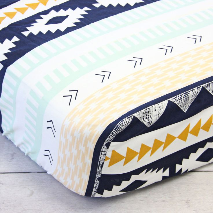This gorgeous crib sheet is perfect for an aztec themed nursery - love the navy, mint, and goldenrod combination!