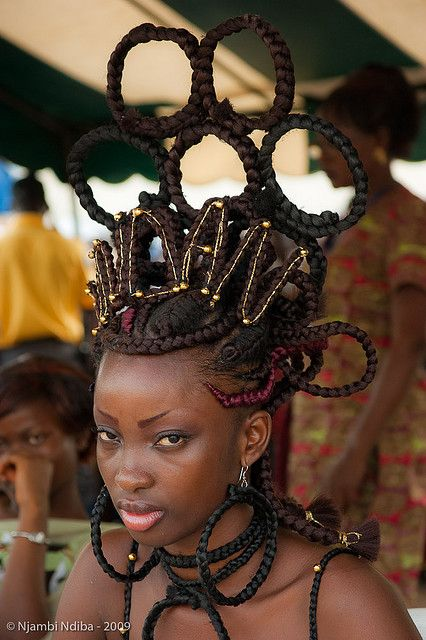 Africa |  Woman taking part in a hair show held in the Ivory Coast.