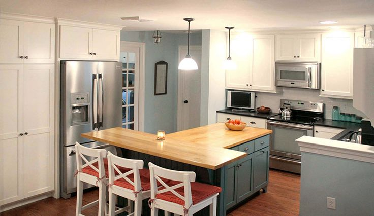 Love this Tshaped kitchen island with wood countertop Contact