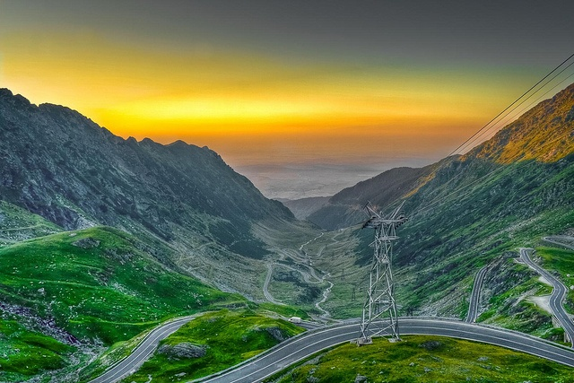 Transfagarasan road and Balea Lake -   The Transfagarasan road consists of 90 kilometers of twists and turns. The road starts near the city of Pitesti (accessible via Bucharest) and links the historic Romanian regions of Transylvania and Wallachia.   When you get to the end (the road climbs up to 2034m), a soothing natural reward will be waiting for you. It is called Balea Lake, and it is the second largest glacier lake in Romania, surrounded by spectacular mountain peaks.