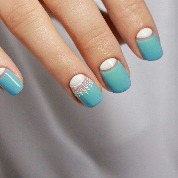 Turquoise nails with white lacy accent