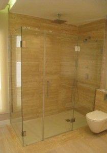 mampara de ducha minimalista fabricada sin perfiles solo cristal de mm y bisagras cromadas
