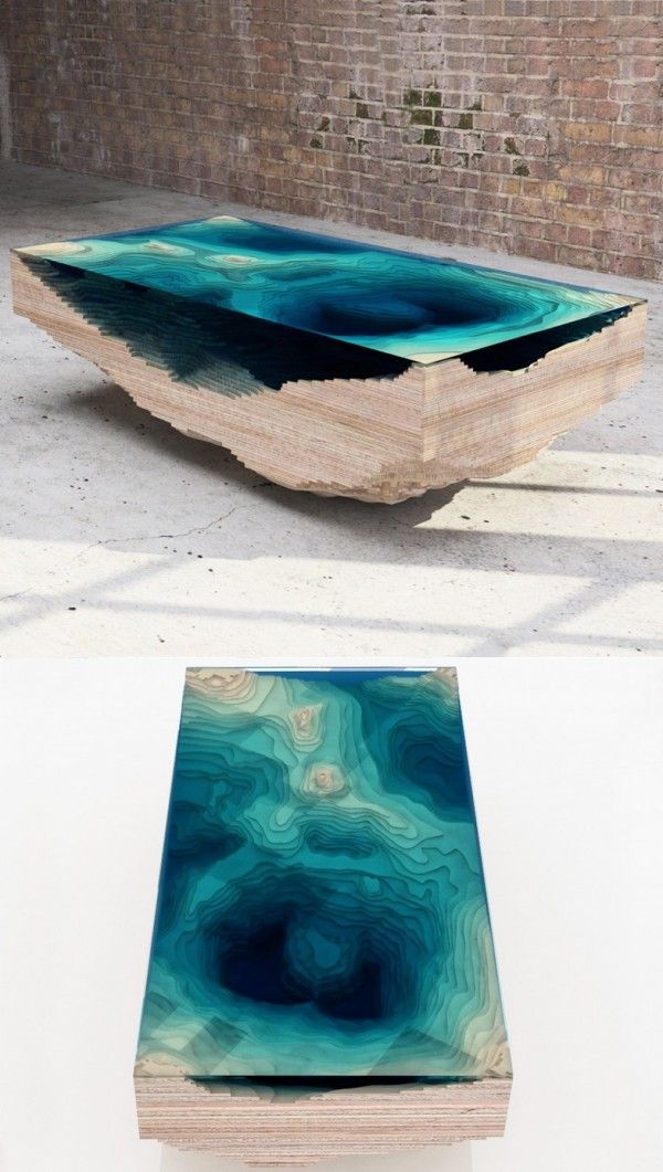 Another table that takes its inspiration from nature. The way the table is cut, it almost appears as if a puddle of clear blue water is suspended in the piece.