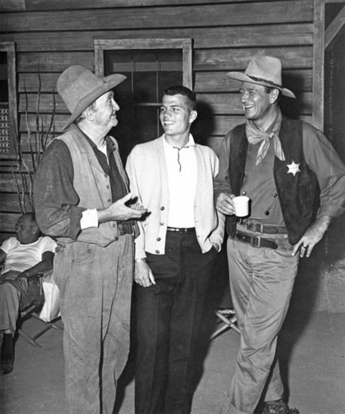 John Wayne and his son Patrick with Walter Brennan on the set of Rio Bravo (1959)