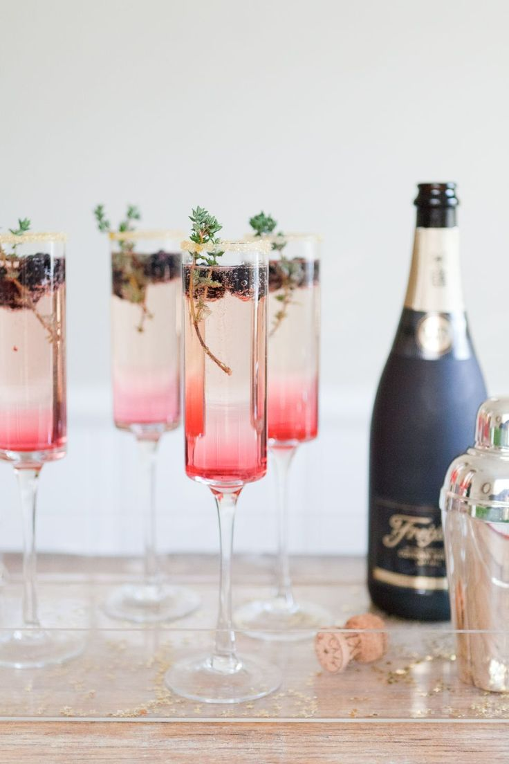 Blackberry Thyme SparklerHomemade blackberry syrup layered with gin and your favorite bubbly creates an ombre effect that is perfect for champagne flutes.  #refinery29 http://www.refinery29.com/champagne-cocktails-recipes#slide-19