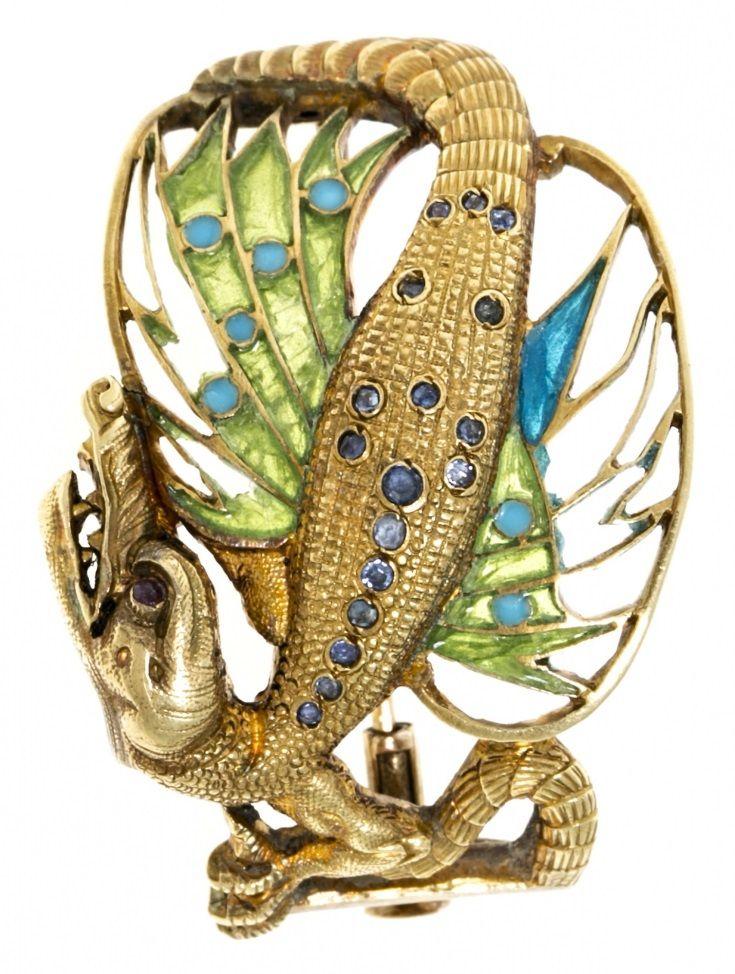 An Art Nouveau gold and plique-à-jour enamel brooch, by Masriera, circa 1903. Designed as a winged dragon. Later alterations. #Masriera #brooch #ArtNouveau
