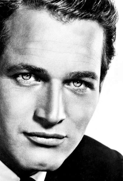 Paul Newman, American actor, film director, entrepreneur, professional race car driver and team owner, environmentalist, social activist and philanthropist. And best-looking person of all time.