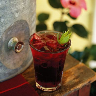 Hibiscus Punch  4 quarts water  2 cups dried hibiscus flower pods (see note)  2 cups superfine sugar, plus more to taste    Garnish:  Fresh hibiscus pods for punch cups or hibiscus flowers to float in punch bowl (optional)
