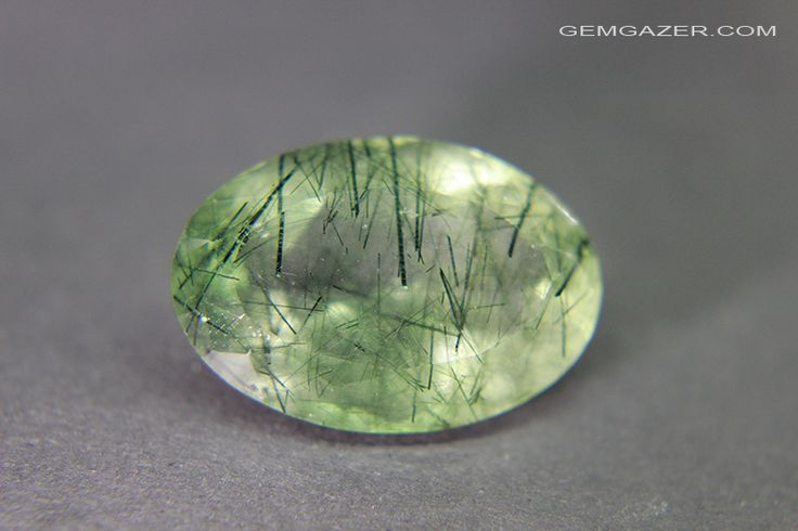 Colourless Quartz gemstone with rod-like green Actinolite inclusions. Brazil. 21.05 carats.