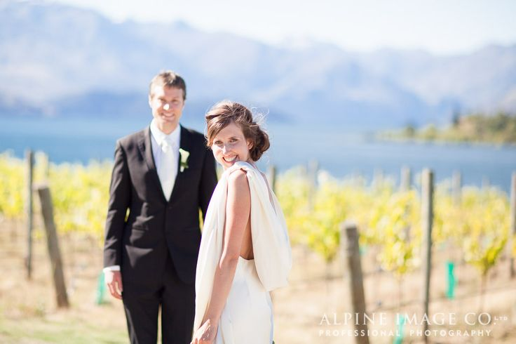 Wedding photos amongst the vines at Rippon, Lake Wanaka