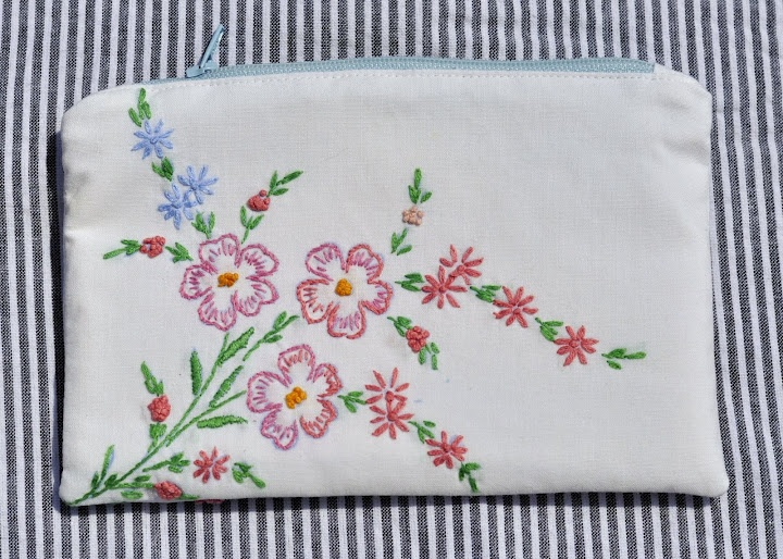 Zippered pouch made from vintage embroidered linens