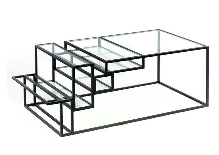 Mariant verre et acier, la table basse de salon design Jointed du designer Belge Filip Janssen joue sur les contrastes. Multifonctionnel et modulaire, cette table basse possède une forte teneur architecturale dans la style atelier d'artiste.