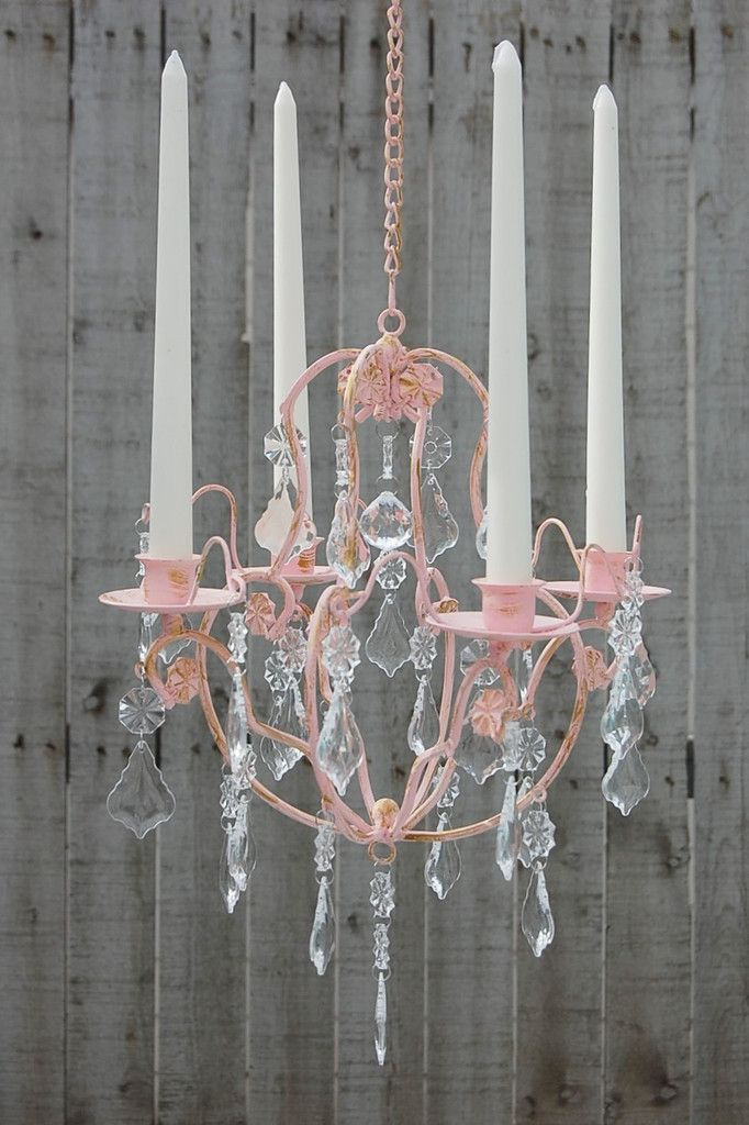 Romantic hanging candle chandelier. Hand painted in soft pink and accented in gold, with a matte protective coating. The chandelier is metal and the prisms are acrylic. This will hold 4 standard taper