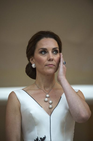 Kate Middleton Photos Photos - Catherine, Duchess of Cambridge listens as Prince William, Duke of Cambridge gives a speech during the Queen's Birthday Garden Party at the Orangery on day 1 of their official visit to Poland on July 17, 2017 in Warsaw, Poland. - The Duke And Duchess Of Cambridge Visit Poland - Day 1
