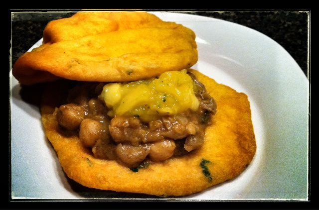 ... bread topped with curried chana and an array of toppings such as mango