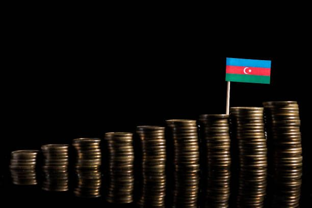 azerbaijan flag with lot of coins isolated on black background