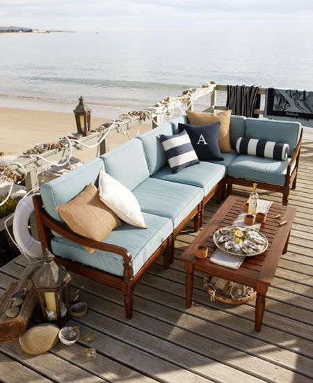 On a porch like this that projects out onto the beach, one¹s instinct is to sit as close to the edge as possible. Here, a sectional tucks right into the corner near the sand and surf that inspired the outdoor-fabric palette