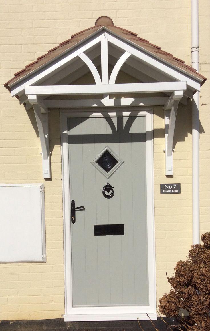 Composite front door. Solidor manufacturer with cast iron door furniture in painswick