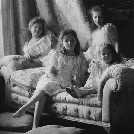 Romanov family (Olga, Tatiana, Marie, and Anastasia) c. 1906 Russia, on a Chesterfield sofa.