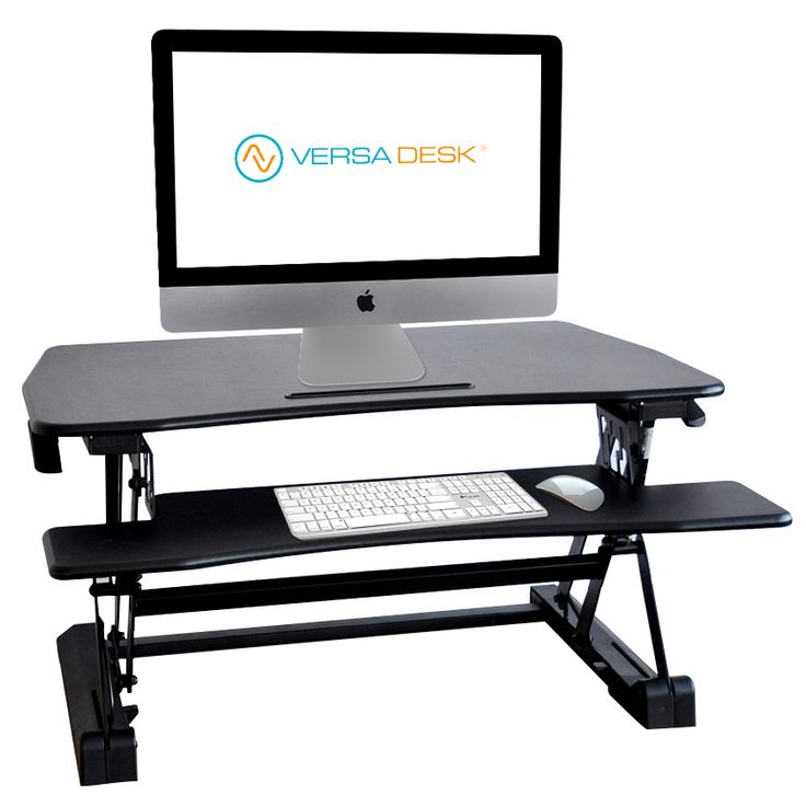 Presenting the Basic Manual Standing Desk Converter, an easy to use manual hinge levered straight height adjustment sit-to-stand desk riser in Black Matrix surface.