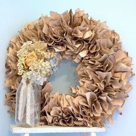 This DIY Paper Wreath can be made with antique paper, book pages, sheet music, or even hymnal pages.