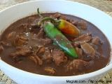 Filipino Recipe Pork Dinuguan (Chocolate Meat)  1 1/2 lbs pork meat, cut in small cubes  1 lb pork stomach  1 1/2 cups pork blood  3/4 cup soy sauce  1 1/2 tbsp vinegar  8 pieces balimbi fruit/kamias, cut into diagonal shape (these are sold in oriental stores' frozen section if the fresh fruit is not available)  4 pieces jalapeño  1 clove garlic, minced  1 medium onion, chopped