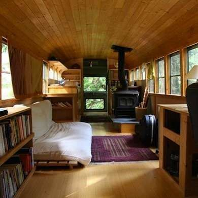 Cozy School Bus Miss your school days? Try living in this cozy converted yellow school bus equipped with a wood stove and a full kitchen. Light oak flooring, shelves, a desk, and a tongue-and-groove ceiling add warmth and charm to the homey space. Best of all, when you tire of the view, you can simply drive away.