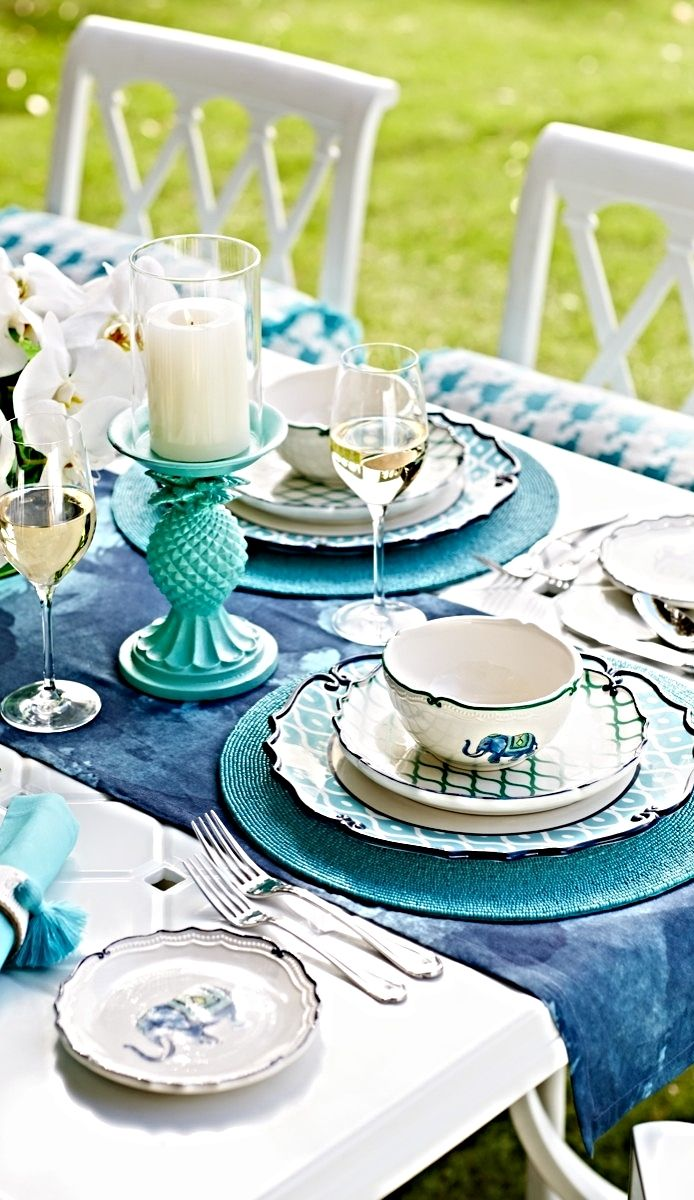Vibrant colors, bold patterns and charming elephants set a cheerful tone for casual meals. | Frontgate: Live Beautifully Outdoors