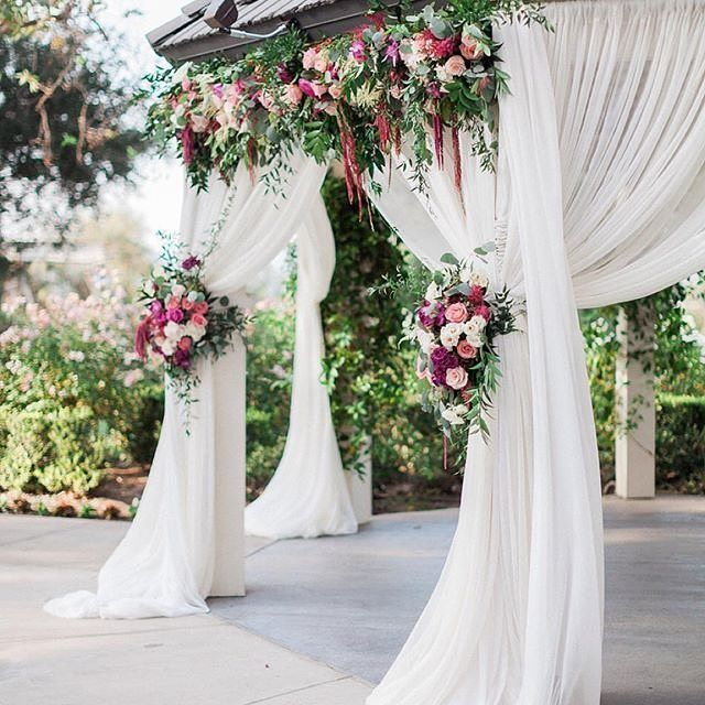 Under a magical setting. The blossoms and blooms of this beautifully draped gazebo by @agoodaffair and @littlehilldesigns are absolutely enchanting! Photo: @bowtieandbloom #realwedding