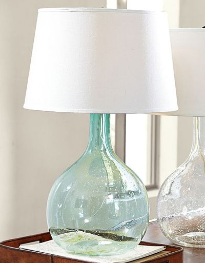 Subtle bubbles and striations provide beautiful evidence of the handcraftsmanship of the Eva Colored Glass Table Lamp. Glass is hand blown. Includes an ivory cotton-linen drum shade. $99. Buy here.