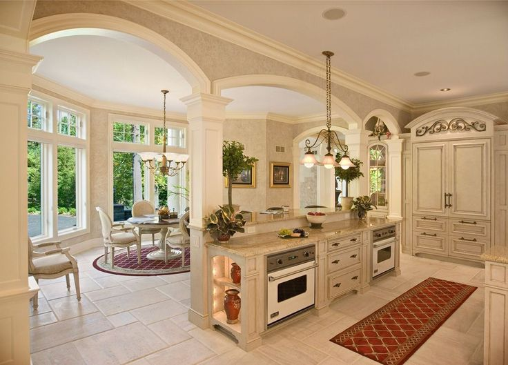 Mediterranean Kitchen with Crown molding, L-shaped, Breakfast nook, Simple granite counters, Inset cabinets, Columns