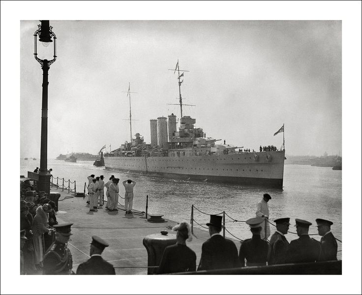HMAS Australia, with the Duke of Gloucester aboard, arrives at a foggy Portsmouth, England, in March 1935.  The Duke of Gloucester had been out to Australia on tour and is greeted home by the Prince of Wales and Duke of York.  HMAS Australia then went on to temporarily join the British Mediterranean Fleet.  Steve Given collection.