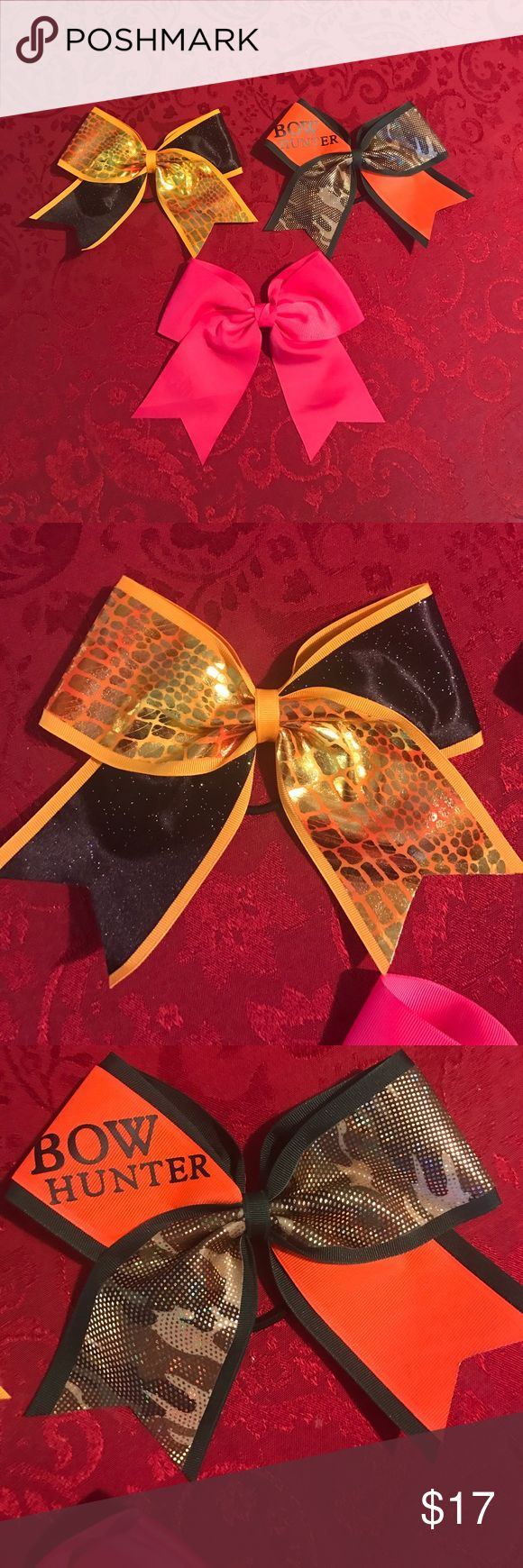 "🎀CHEER BOW BUNDLE🎀 I have three cheerleading bows in this bundle. The first one is black and yellow with a hair tie, the second one is green, orange, and camo, says, ""BOW HUNTER"", and has a hair tie, and the last one is just solid pink with a clip. They have never been used. Accessories Hair Accessories"