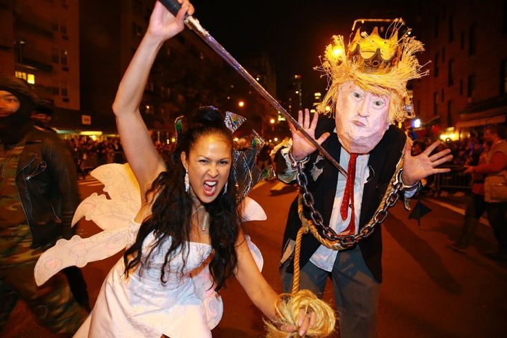 Marni Halasa brandishes a sword in front of a man in a Donald Trump costume with a sword at the 44th annual Village Halloween Parade in New York City on Oct. 31, 2017. (Photo: Gordon Donovan/Yahoo News)