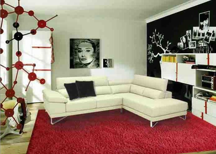 Super fun white modern couch.  Love the pop art!