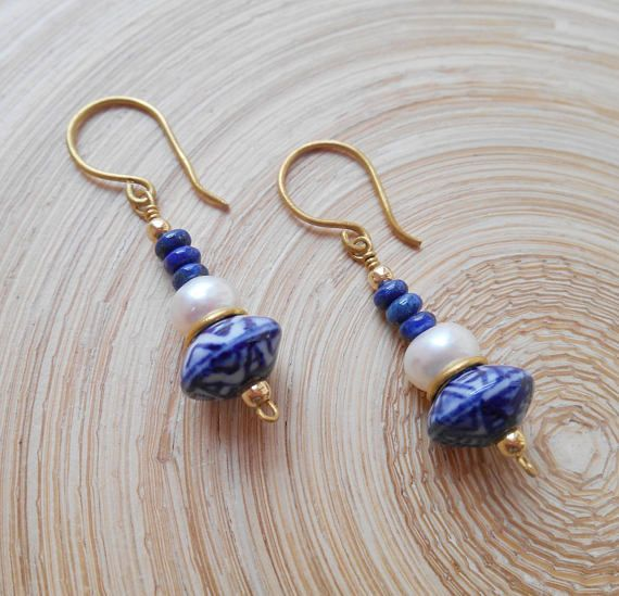 Lovely delft blue style earrings made of delft blue style handpainted ceramic beads, lustrous white freshwater pearls and navy blue lapis lazuli smooth rondelles wire wrapped with gold filled wire. Minimal, comfortable and with a beachy vibe, Delft earrings are a perfect gift for