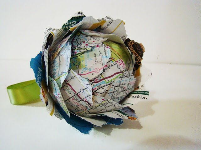 Kissing Ball ornament...I would use any scrapbook paper, fabric, maybe painted newspaper (just paint newspaper with paint or watercolors), old scarves, old silk ties, possibly tissue paper too!