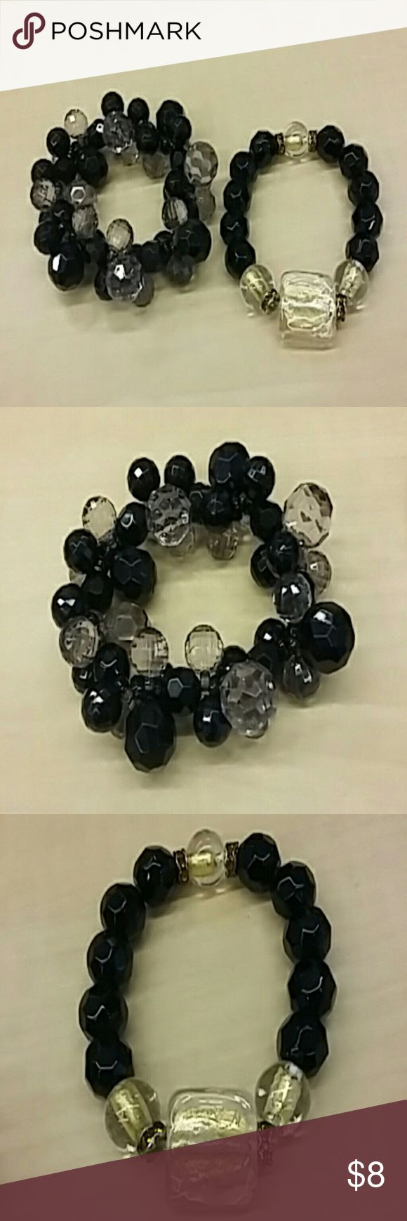 Lot of jet and crystal bead stretch bracelets One bracelet is faux jet and smoky gray faux crystal beads on stretch band; other bracelet is faux jet and crystal and gold beads with topaz rhinestone accents on strtch band. Very nice worn separately or together. PRICE INCLUDES BOTH BRACELETS! Jewelry Bracelets